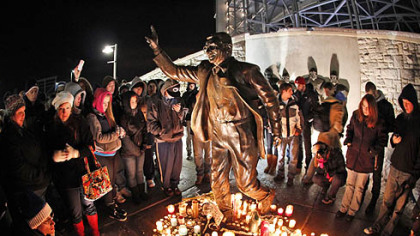 People gathered Saturday night around a statue of Joe Paterno outside Beaver Stadium on the Penn State University campus.