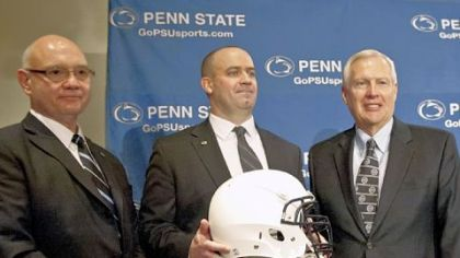 Penn State's new football coach Bill O'Brien, center, poses with acting athletic director Dave Joyner, left, and university president Rodney Erickson, after he was introduced during a news conference Jan. 7 in State College.