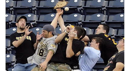 Pirates fans try to catch a home run ball hit by Washington's Wilson Ramos in the third inning Tuesday night at PNC Park.