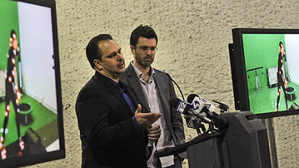 Chris Breakwell, left, CEO of 31st Street Studios, stands with James Knight of Knight Vision to describe how the motion capture operation would operate.