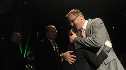 Penguins coach Dan Bylsma hugs son Bryan, 13, at the Dapper Dan Dinner and Sports Auction.