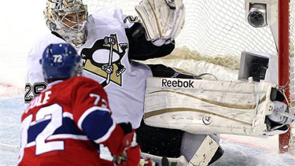 Marc-Andre Fleury stops a shot by Canadiens right wing Erik Cole in the second period Tuesday in Montreal.