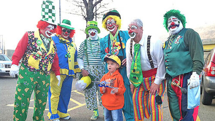 Four-year-old Caiden Smith was introduced to some fashion-forward clowns accessorized for today&#039;s St. Patrick&#039;s Day parade, Downtown.