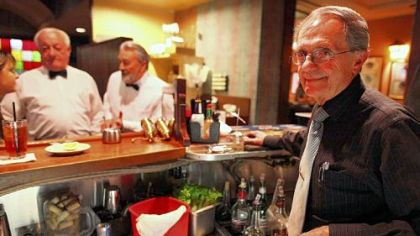 Bartender Fernando Gomez, right, and servers Jose Fragoso and Bernard Inchauspe, left, have worked for decades at the French restaurant Taix in Los Angeles, California's Echo Park neighborhood.