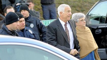 Jerry Sandusky arrives with his wife, Dottie, at the Centre County Courthouse in Bellefonte on Dec. 13.