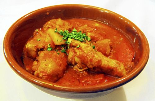 At Paris 66, the Chicken Basquaise was braised in a heavenly sauce of ...