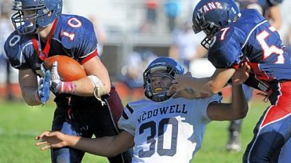 Shaler's J.P. Holtz, left. returns an interception for a touchdown to put a game away against Erie McDowell in October.