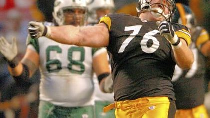 The Steelers&#039; Chris Hoke celebrates after sacking New York Jets quarterback Chad Pennington during a division round playoff game in January 2005 at Heinz Field.