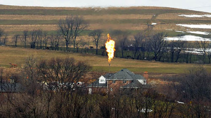 Flames shoot from a well in Mount Pleasant. Washington County.