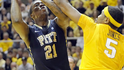Pitt forward Lamar Patterson tries to get past West Virginia's Kevin Jones to score.
