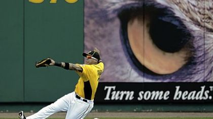 Right fielder Jose Tabata makes a sliding catch of a ball hit by Boston&#039;s Ryan Lavarnway Wednesday in Bradenton, Fla.