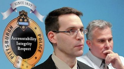 Pittsburgh police Cmdr. Thomas Stangrecki, left, and Allegheny County District Attorney Stephen A. Zappala Jr. answer questions about Tuesday's armored car robbery and what they described as the calculated killing of one of the crew.