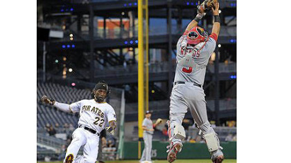 Pirates&#039; Andrew McCutchen scores past Nationals catcher Wilson Ramos.