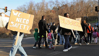Two dozen people picketed the intersection of Second and Glenwood avenues in Hazelwood to protest speeding traffic where children wait for and board school buses.