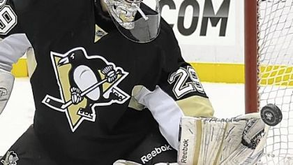 Marc-Andre Fleury makes one of his 28 saves against the Panthers Friday at Consol Energy Center.