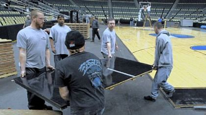 Workers at Consol Energy Center convert the floor to a basketball court for this weekend's NCAA men's basketball tournament.