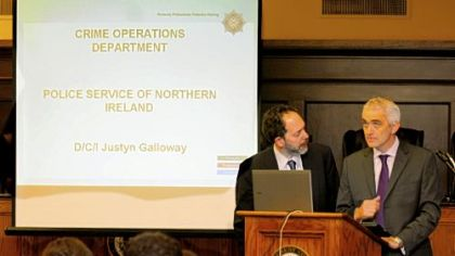 Cybergenetics' Mark W. Perlin, left, and Belfast Detective Chief Inspector Justyn Galloway talk about advanced DNA technology Friday at the Allegheny County Courthouse.