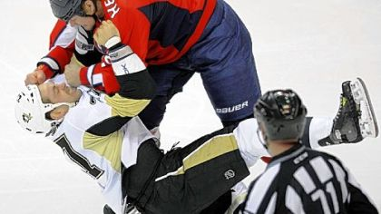 Washington's Matt Hendricks, top, gets the better of Craig Adams in the first period Wednesday in Washington.