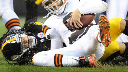 Steelers Troy Polamalu sacks Browns quarterback Seneca Wallace in the first half of tonight's game in Cleveland.