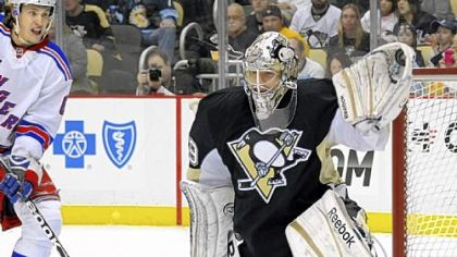 Marc-Andre Fleury gloves one of his 27 saves en route to his franchise record-tying 22nd career shutout in the Penguins' 2-0 win vs. the New York Rangers.
