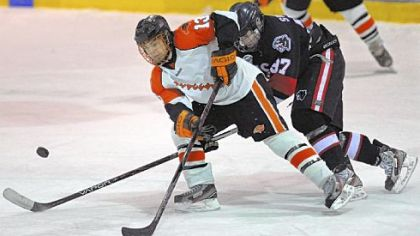 Bethel Park's Zack Volzer and Upper St. Clair's Michael Sweeney battle for possession of the puck during the second period of the Black Hawks' 3-2 victory in a PIHL Class AAA game last week.