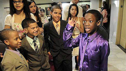 Fekens Dusch, 12, of Bon Air, shows his dance moves to the Owens brothers, from left, Kensly, 9, Gavin, 8 and Ayden, 11, after his adoption process at Allegheny County Orphans Court today.