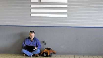 Gil Garcia, 55, of Hilton Head, S.C., waits for his flight at the Pittsburgh International Airport on March 6. Mr. Garcia, a software engineer, was in Pittsburgh for a business trip.