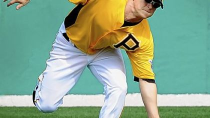 Nate McLouth makes a catch at Pirates spring training Sunday in Bradenton, Fla.