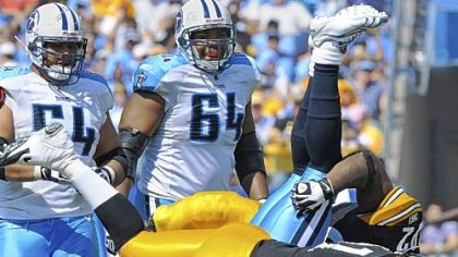 Steelers Aaron Smith stands Titans quarterback Vince Young on his head in a 2010 game.