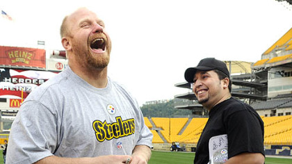 The Steelers' Chris Hoke, jokes with Axy Ruiz of Erie, with his step-son Jonnathon Ulrich, 7, in the background at the Heroes At Heinz Field in 2008. Ruiz, was an Army MP, a Spec. E-4, who served in Iraq in 2004.  The Steelers and VA Healthcare-VISN 4 brought about 7 players and over 100 veterans of Operation Enduring Freedom and Operation Iraqi Freedom and their families together for skill events on the field and a dinner.