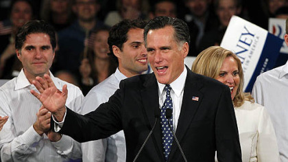 "Former Massachusetts Gov. Mitt Romney waves to supporters at the ""Romney for President"" New Hampshire primary night rally at Southern New Hampshire University in Manchester, N.H. Behind him are his sons, Tagg and Craig, and his wife, Ann."