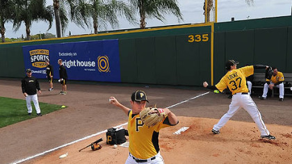 Gerrit Cole, left, at work in the bullpen this week, part of the slow, daily grind toward becoming the ballplayer he wants to be and that the Pirates envisioned when they selected him No. 1 overall out of UCLA in the June draft.
