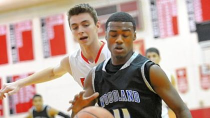 Woodland Hills' D.J. Kyles fights for the ball Tuesday with Fox Chapel's Matt D'Amico.