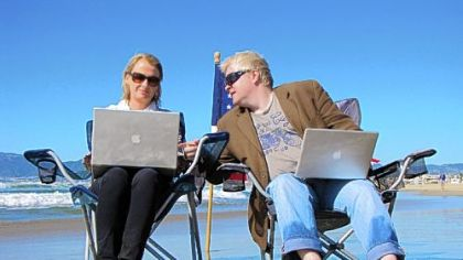"""FrackNation"" creators Ann McElhinney and Phelim McAleer sitting on the beach at Marina del Rey in greater Los Angeles."