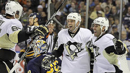 The Penguins' Steve Sullivan celebrates his goal with teammates Sidney Crosby and Pascal Dupuis on Buffalo Sabres goalie Ryan Miller during the second period of tonight's game in Buffalo, N.Y.
