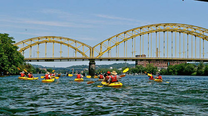 A group of kayakers explore the Three Rivers during Venture Outdoors annual Pedal, Paddle, Peduto event.