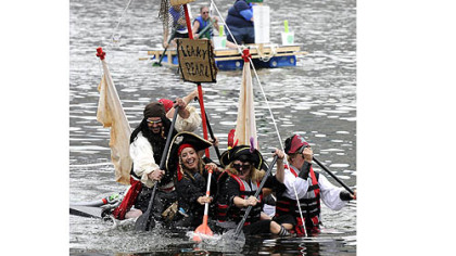 Despite taking on water, the Leaky Pearl Pirate float, sailed by a group of friends from Mt. Lebanon, took second place in the Anything That Floats Race on the Allegheny River during last year's Three Rivers Regatta.