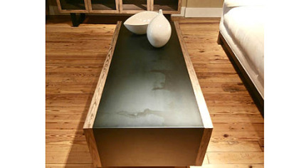 Maria Yee's hot rolled steel coffee table framed in Nordic pine.