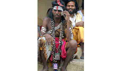An Indian sadhu places a call.