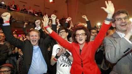 Social Democratic Party members react happily Sunday to the first results published in Duesseldorf, Germany.