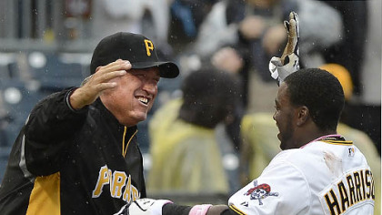 Manager Clint Hurdle greets Josh Harrison after Harrison's walk-off single in the 12th inning.