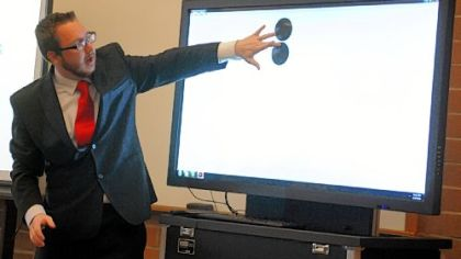Joshua Sager, program director for multimedia technologies at Pittsburgh Technical Institute works, with a Kore Images interactive display during a presentation on the technology at Pittsburgh Technical Institute in Oakdale.