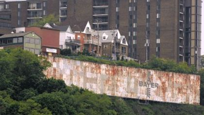 The rusted iconic Pittsburgh sign atop Mount Washington.