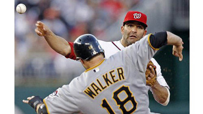 Washington Nationals second baseman Danny Espinosa throws over Pirates' Neil Walker  to connect for the double play on a ball hit by Andrew McCutchen.