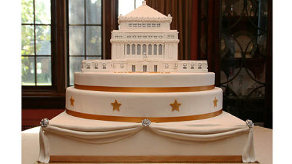 This cake depicting Soldiers & Sailors Memorial Hall in Oakland was created == using actual blueprints -- by Nancy Becker, left, of Madison Ave Specialty Cakes.