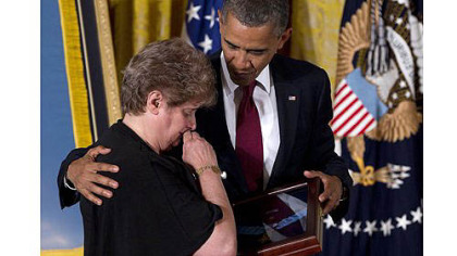 President Barack Obama posthumously awards the Medal of Honor to Rose Mary Sabo-Brown, widow of Army Spc. Leslie H. Sabo Jr., during a ceremony Wednesday in the East Room of the White House. Sabo was killed in 1970 in Cambodia during the Vietnam War.