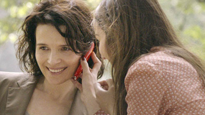 "Playing a journalist, Juliette Binoche (left) gets involved in a story about college call girls, including Anais Demoustier, in ""Elles."""