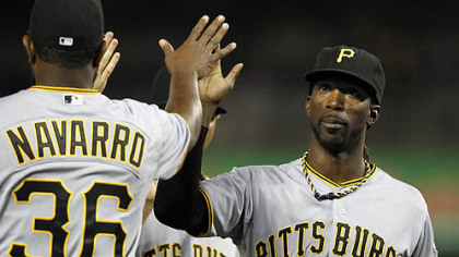 Pirates center fielder Andrew McCutchen, right, high-fives Yamaico Navarro after their 5-3 victory against the Nationals Thursday in Washington. McCutchen hit two home runs in the game.