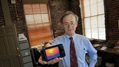 Jim Fitzgerald, founder of The WatchWord Bible, shows his iPhone app.