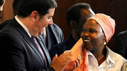 Pittsburgh councilman Bill Peduto applauds Hawa Abdullah as she receives a proclamation from City Council.